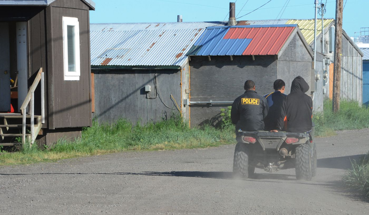 Village police officers ride a four wheeler through the village of Stebbins, one of at least 14 Alaska villages that has hired village police officers with criminal records. (Bill Roth / ADN)