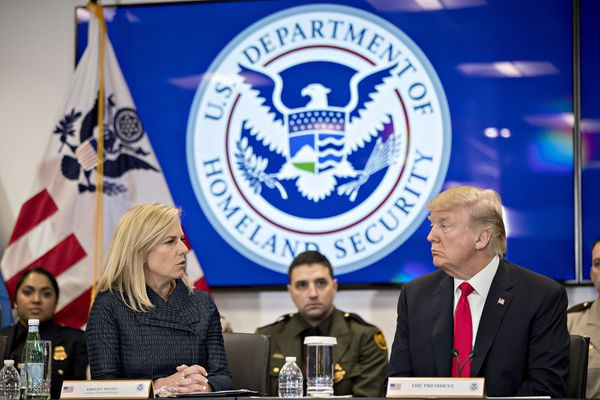 President Donald Trump (right) listens as Homeland Security Secretary Kirstjen Nielsen speaks during a Customs and Border Protection (CBP) roundtable discussion at the CBP National Targeting Center in Sterling, Virginia, on Feb. 2, 2018. MUST CREDIT: Bloomberg photo by Andrew Harrer.