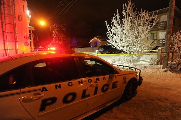 Anchorage Police investigate a homicide at the 4100 block of Peterkin Avenue in Mountain View in Anchorage, Alaska, on Saturday, December 24, 2016. Anchorage Police indicated that two people were dead at the scene. (Bob Hallinen / Alaska Dispatch News)