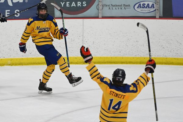 Homer juniors Casey Otis and Kazden Stineff celebrate a goal during the Mariners' 6-3 victory over the Houston Hawks during the First National Cup Division II state hockey tournament at the Menard Center in Wasilla on Thursday, Feb. 18, 2021. (Bill Roth / ADN)