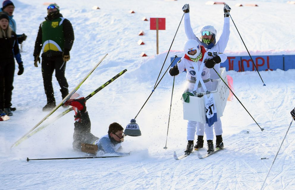 Service's Maya Brubaker, front, and Garvee Tobin celebrate after landing a jump while Eagle River's Garrett Kimball wipes out. (Matt Tunseth / ADN)