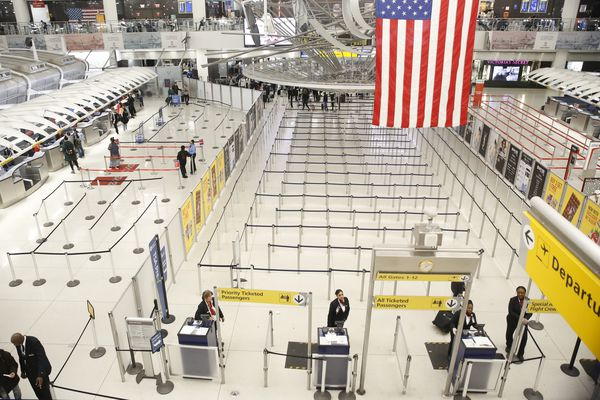 The area for TSA screening of travelers at JFK airport's Terminal 1 is relatively empty, Friday, March 13, 2020, in New York. (AP Photo/Kathy Willens)