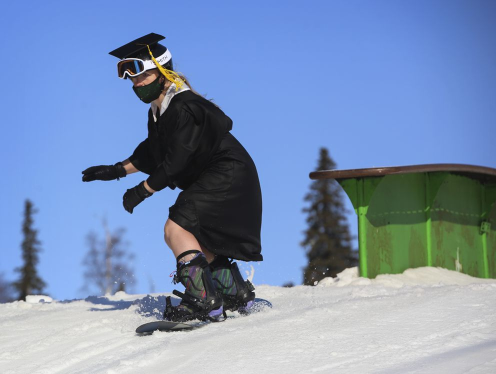 Shelbee Davis clears a ramp while snowboarding at Hilltop after her college graduation. (Emily Mesner / ADN)