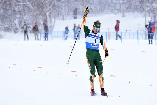 Service's Alexander Maurer raises his hand after winning the boys 10-kilometer classic technique race at the ASAA/First National Bank Alaska High School Nordic Ski Championships on Friday, Feb. 21, 2020 at Kincaid Park in Anchorage. (Matt Tunseth / ADN)