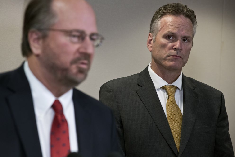 Gov. Mike Dunleavy listens as Attorney General Kevin Clarkson answers questions from reporters in Anchorage on September 26, 2019. (Marc Lester / ADN)
