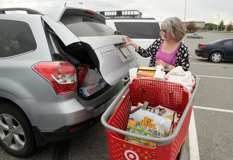 Terri Bellah loads her shopping into her car at the Wasilla, AK Target store on Friday, July 13, 2018. Target is using 2.25 mil reusable plastic bags. Bellah brought one bag with her but ended up buying more stuff then would fit in the one bag. (Bob Hallinen / ADN)