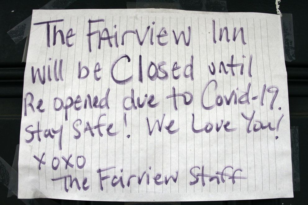 In this June 2, 2020, photo a closed sign is posted at the Fairview Inn in Talkeetna, Alaska. Talkeetna businesses are suffering in the financial pinch caused by the coronavirus, which led to the national park canceling this year's climbing season and the cancelation of summer seasons by most major cruise companies. As a result nearly half of Alaska's annual 2.2 million visitors won't be visiting the nation's northernmost state. (AP Photo/Mark Thiessen)