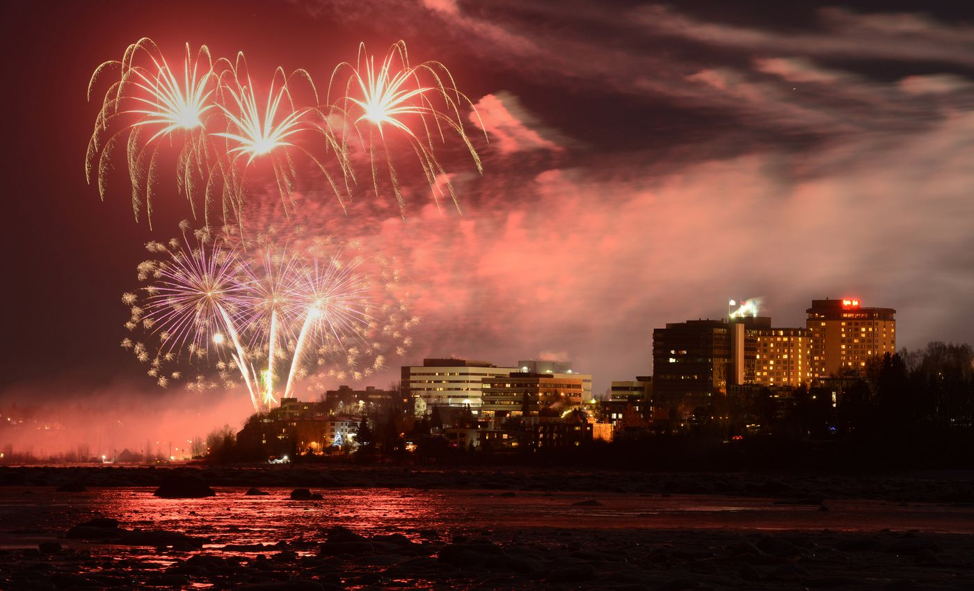 Fireworks burst over downtown Anchorage during a scaled back New Years Eve celebration on Thursday, December 31, 2020. (Bob Hallinen)