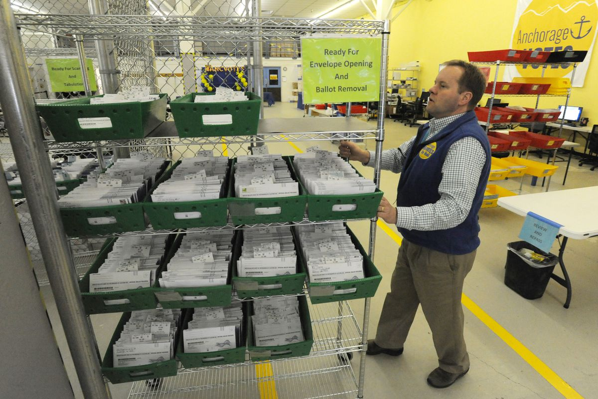 Dennis Wheeler moves ballot envelopes that have been sorted by precinct and are ready for ballot removal at the MOA Election Center on Election Day, April 2, 2019, during the regular municipal election. (Bill Roth / ADN)