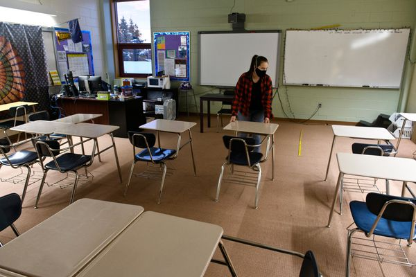 Eighth grade language arts teacher Amy Sommers moves desks in her classroom at Skyview Middle School in Soldotna on January 8, 2021. (Marc Lester photo)