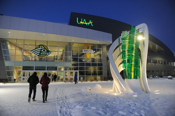 """People walk towards the Alaska Airlines Center for a basketball game between Western Oregon and UAA in Anchorage, Alaska on Saturday, Jan. 27, 2018. A new addition to the site is the sculpture """"Lucerna"""" by New York City based artist Osman Akan. (Bob Hallinen / ADN)"""