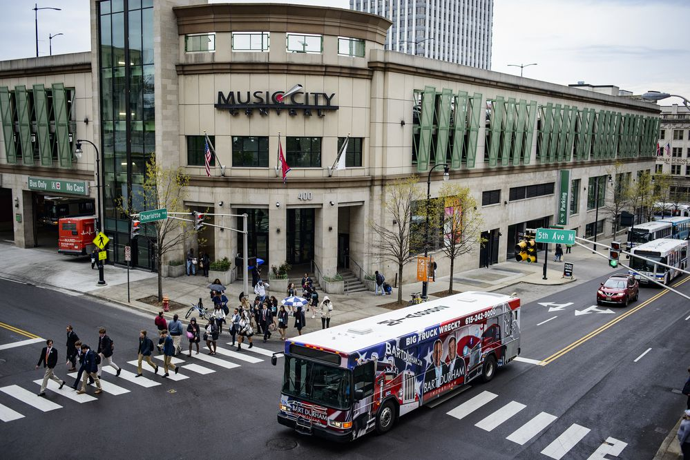 **EMBARGO: No electronic distribution, Web posting or street sales before 2:01 a.m. ET Tuesday, June 19, 2018. No exceptions for any reasons. EMBARGO set by source.** A bus passes Music City Center, the transportation hub in downtown Nashville, Tenn., March 6, 2018. In communities across the country, the billionaire conservative Koch brothers are waging a sophisticated fight against new rail projects and bus routes. (William DeShazer/The New York Times)