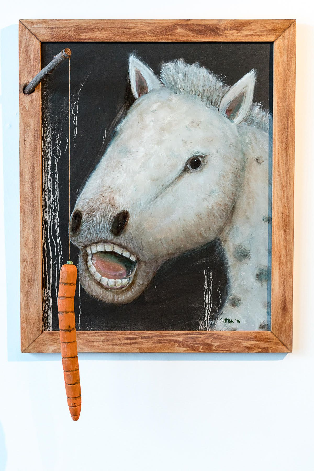 """How I Added Horse Wrangling to my Resume,"" oil, string and wooden carrot, at IGCA. By Scott Pugh (Courtesy of the artist)"