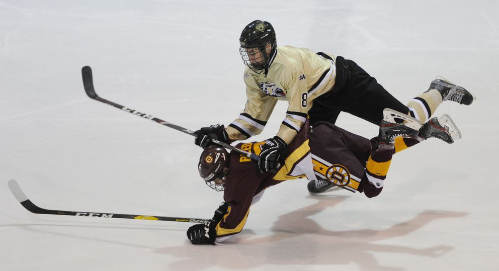 Dimond's Landen Reed is checked by South's Hayden Fox. (Bill Roth / ADN)