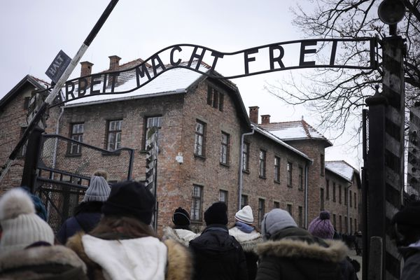 Visitors pass through the main gate bearing the inscription 'Arbeit Macht Frei' at the Auscwitz-Birkenau concentration camp museum in Auscwitz-Birkenau, Poland, on Feb. 28, 2018. MUST CREDIT: Bloomberg photo by Piotr Malecki.