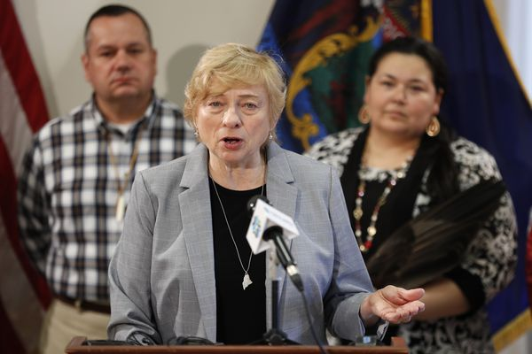 Maine Gov. Janet Mills speaks at the signing ceremony to establish Indigenous Peoples' Day, Friday, April 26, 2019, at the State House in Augusta, Maine. Mills added Maine to the growing number of states who have passed similar legislation. William J. Nicholas Sr., Governor of the Passamaquoddy Tribe-Indian Township, left, and Clarissa Sabattus, Tribal Chief of Houlton Band of Maliseet Indians attend the event. (AP Photo/Robert F. Bukaty)