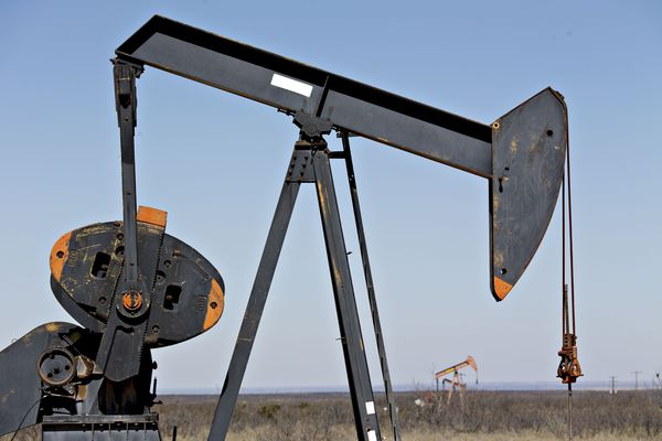 Pumpjacks operate on oil wells in the Permian Basin near Crane, Texas on March 2, 2018. Bloomberg photo by Daniel Acker