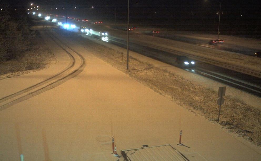 Snow accumulates along the Glenn Highway near the weigh station early Monday. (Borealis Broadband Inc.)