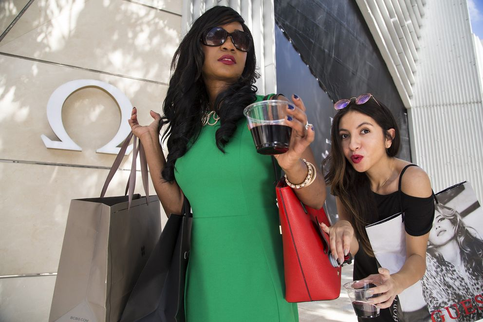 Porto Vino Purse, one of the items for the 2017 Dave Barry Gift Guide. Actors are Aline Monestime, left, and Leslie Ovalle in front of Omega Boutique in Miami Design District. (CARL JUSTE/MIAMI HERALD/TNS)