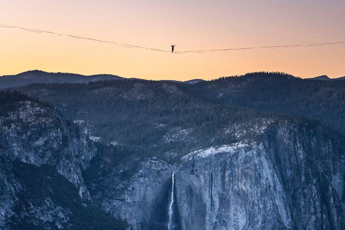Highliner Daniel Monterrubio walks a 2,800-foot line off Taft Point above Yosemite Valley in Yosemite, Calif. (Scott Oller/Scott Oller Films via AP)