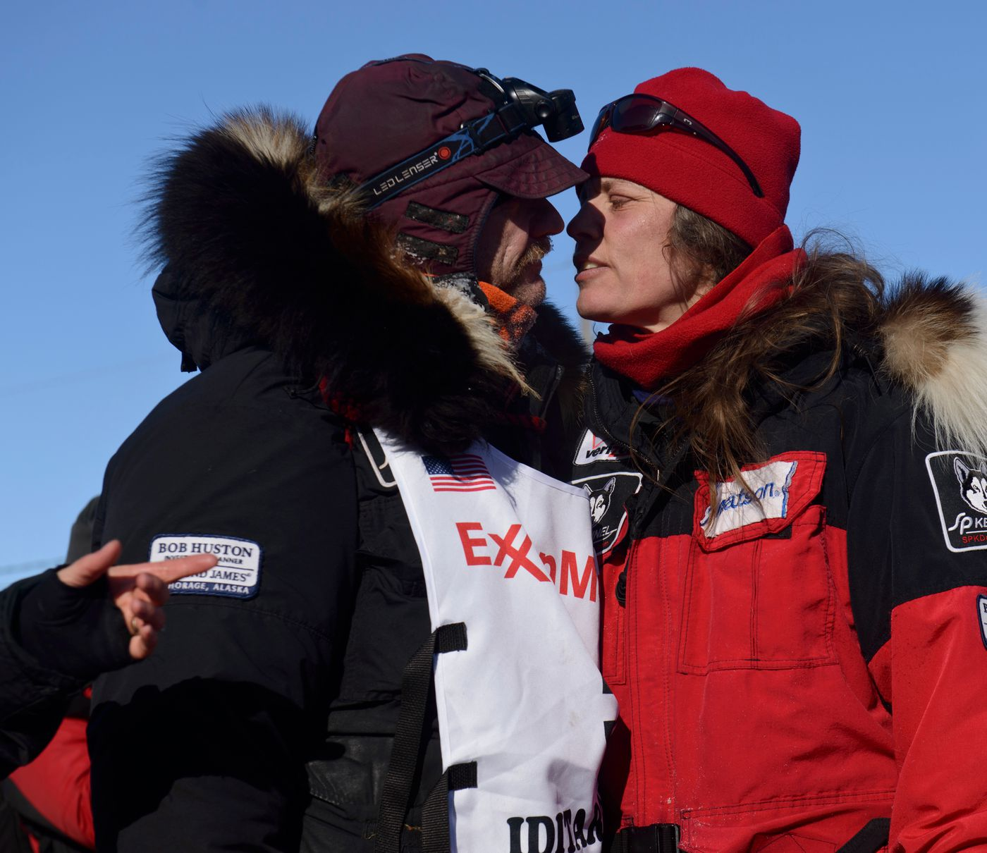 Allen Moore is greeted by his wife, Aliy Zirkle, after Moore arrived on Front Street during the Iditarod on March 16, 2016. (Marc Lester / ADN archive)