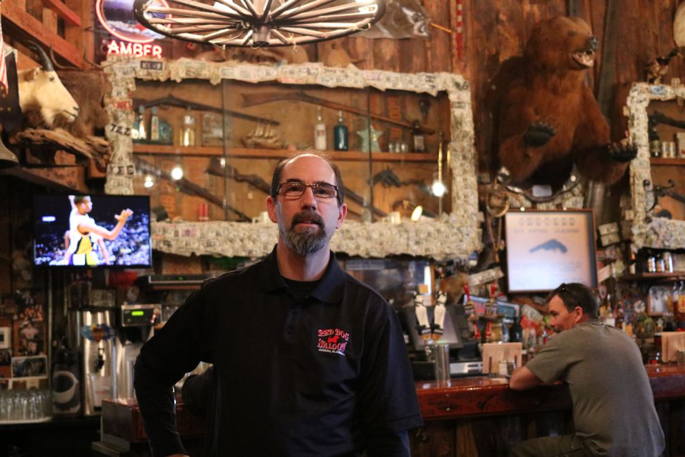 Eric Forst stands inside the Red Dog on Thursday. Forst, a co-owner of the bar, said bar owners are threatened by the proliferation of craft breweries and distilleries in Alaska, which are competing for customers. (Nathaniel Herz / ADN)