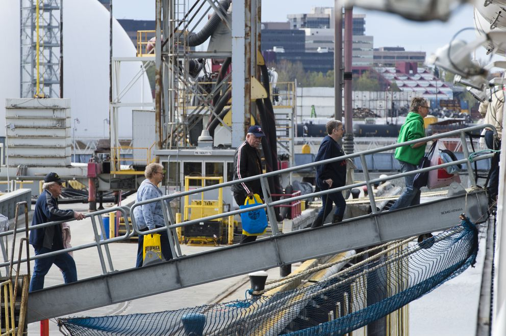 Passengers return to the Zaandam from buses.  (Marc Lester / ADN)