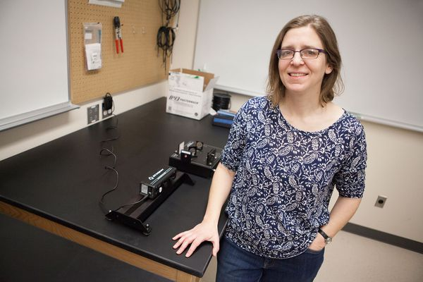 Physics professor Katherine Rawlins discusses interferometers in the Natural Science Building on the University of Alaska Anchorage campus Tuesday.