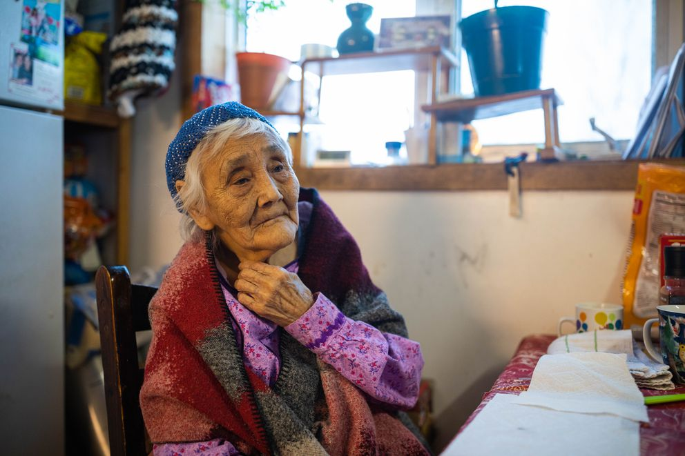 Marie Askoak, 90, at her kitchen table. Askoak is the oldest person in the village. (Loren Holmes / ADN)