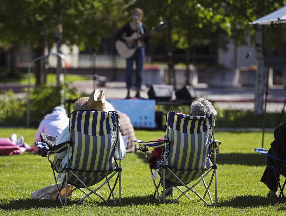 People listen to Anchorage musician Ava Earl as she performs on the front lawn of the Anchorage Museum downtown on Friday, June 4, 2021. (Emily Mesner / ADN)