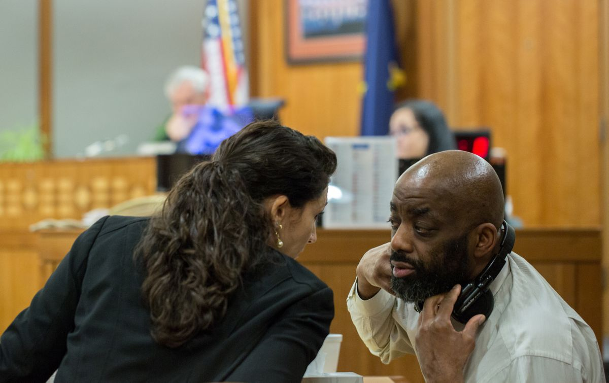 Assistant public advocate Kimberly Tsaousis confers with defendant Troy Williams on Wednesday at the Nesbett Courthouse in Anchorage. (Ash Adams)