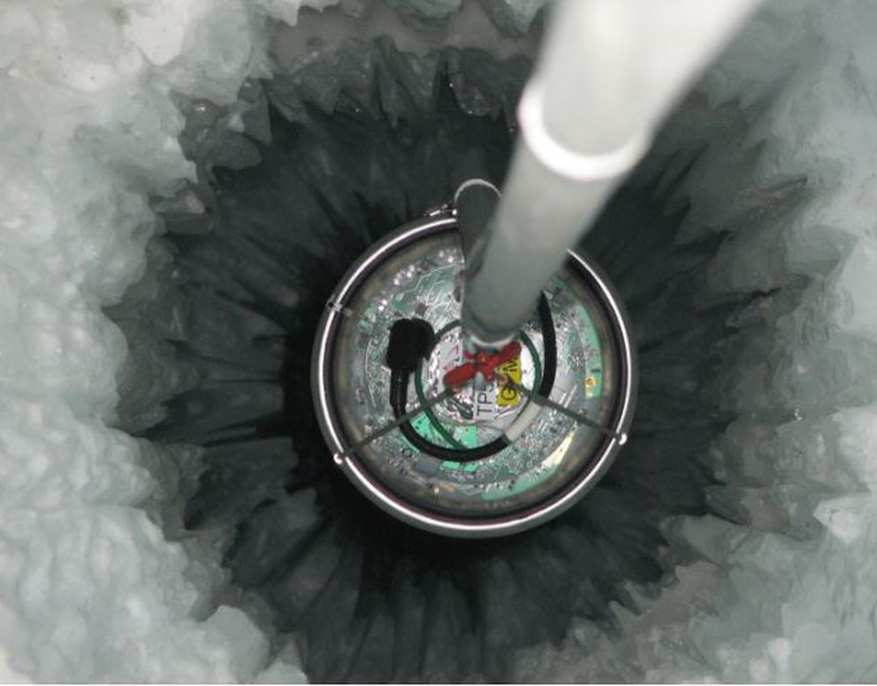 An IceCube sensor is dropped into a mile-deep hole in the Antarctic ice. MUST CREDIT: Photo for the National Science Foundation by Mark Krasberg