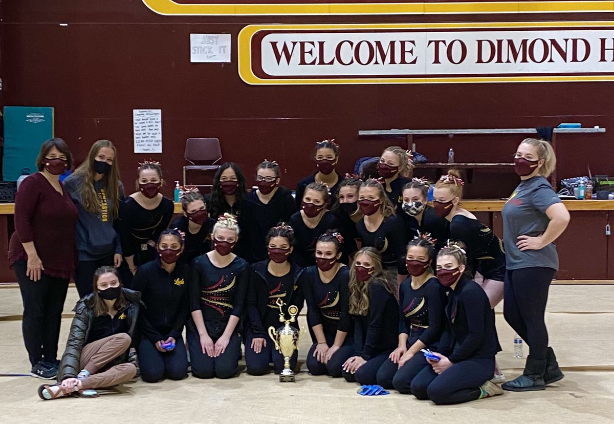 Dimond High gymnasts pose with their trophy after winning the Cook Inlet Conference meet Saturday at Dimond High (Photo by Urban Enkvist)