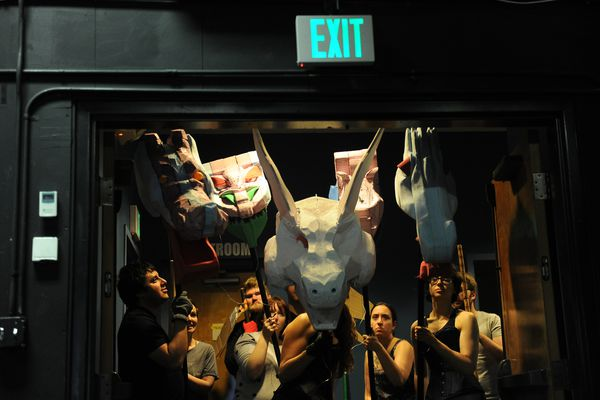 "The dragons wait to make their entrance during a fight scene rehearsal for the production of ""She Kills Monsters"" in Anchorage, Alaska on Tuesday, Sept. 5, 2017. Cyrano's has moved to a new location at 3800 Debarr Road. (Bob Hallinen / Alaska Dispatch News)"