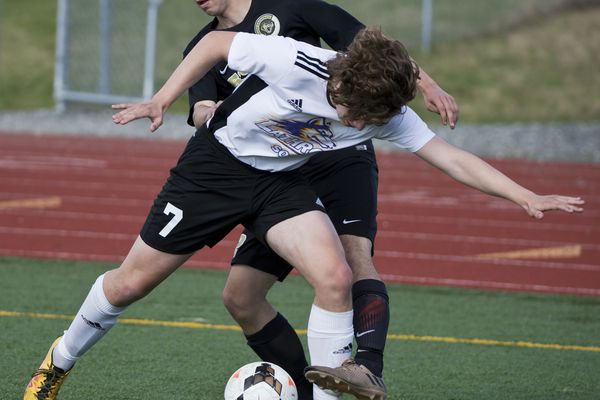 Blaise Baker. Lathrop's Caedon Ott, front, works against South's Lathrop played South in the boys soccer state championship tournament on May 24, 2018. (Marc Lester / ADN)