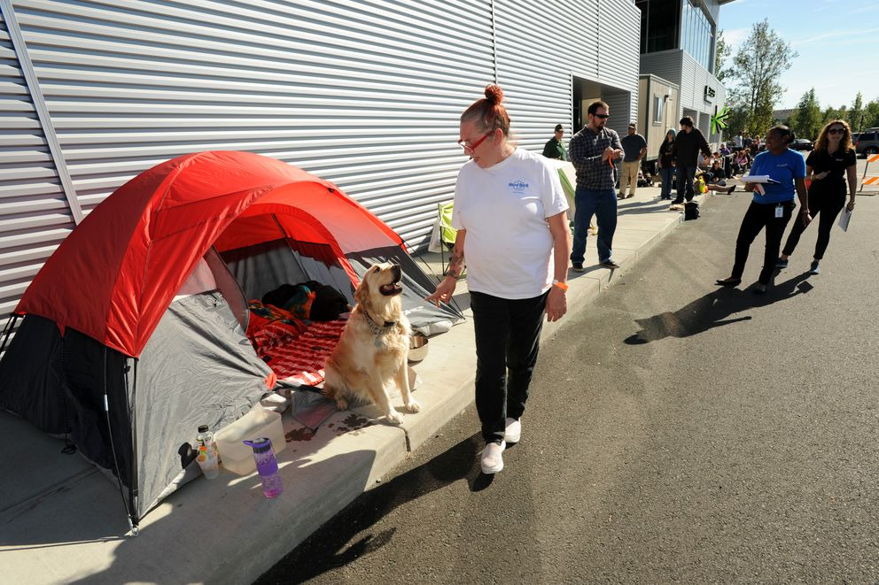 Sherry Kelly and Moose camp out near the front of the line outside Krispy Kreme Doughnuts on Monday, August 29, 2016, at Creekside in Muldoon for the Tuesday opening of the national chain. (Erik Hill / ADN)