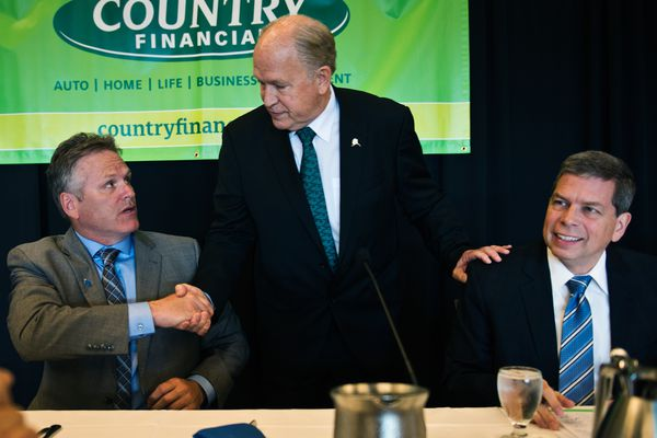 Candidates greet each other before the event begins. From left are Mike Dunleavy, Gov. Bill Walker and Mark Begich. Four candidates for governor participated in a lunchtime forum hosted by the Anchorage Chamber of Commerce at the Dena'ina Center on September 10, 2018. (Marc Lester / ADN)