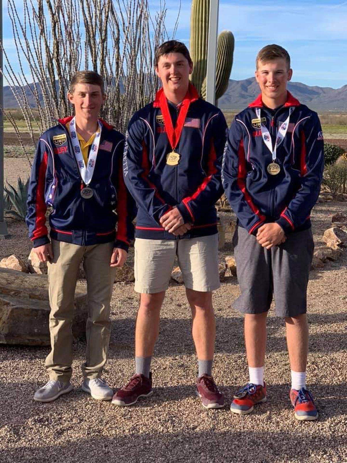 Gold-medal winner Steven Brown, center, and bronze-medal winner Grayson Davey, right, pose after earning medals at a USA Shooting competition in Tucson, Arizona. On the left is silver medalist Roe Reynolds of Quitman, Arkansas. (Photo by John Thompson)