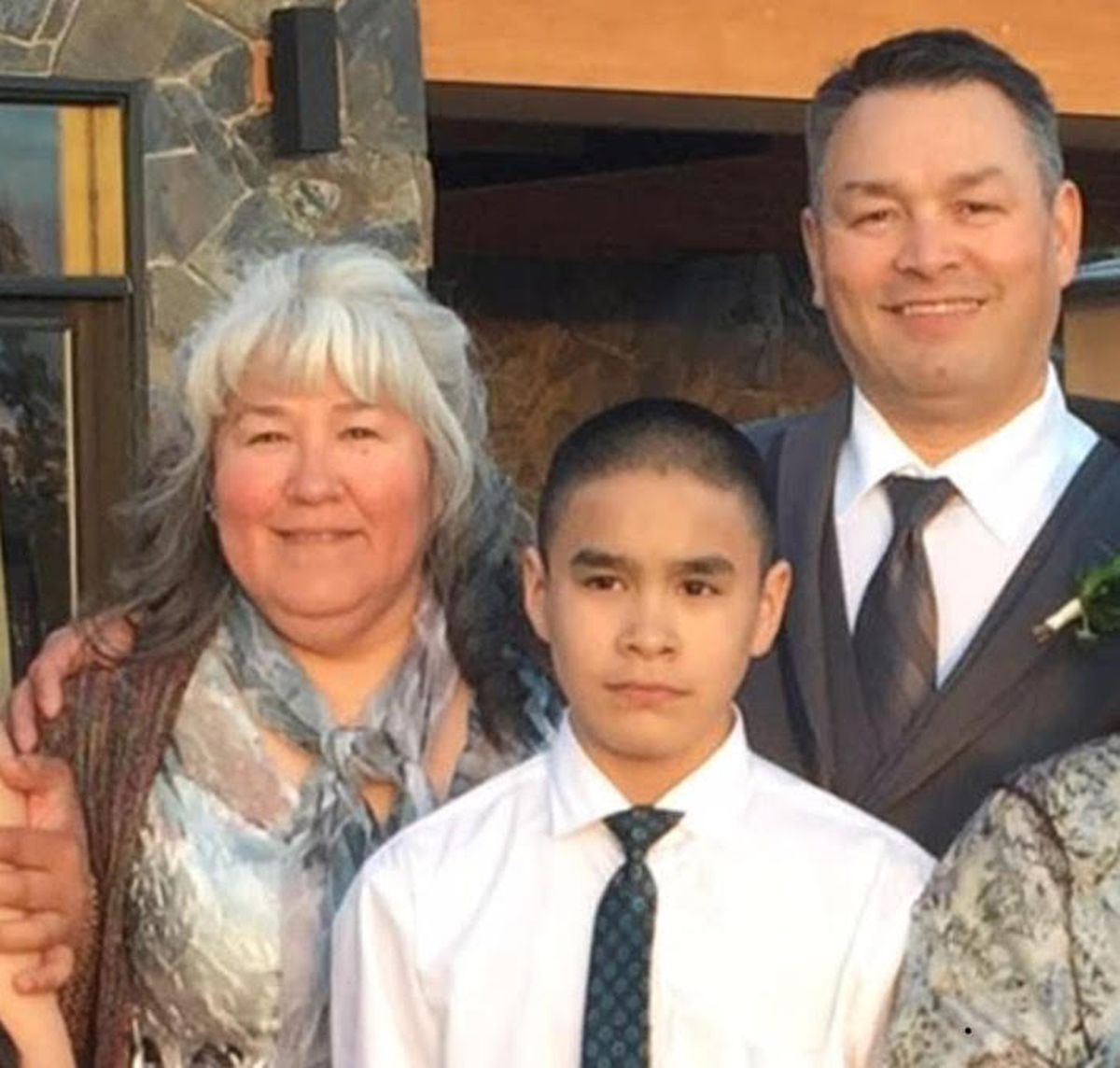 Crawford Sue Patkotak with his parents, Crawford and Laura Patkotak, in an undated photo. Crawford Sue Patkotak was stabbed and killed by another family member Wednesday, Oct. 18, 2017, in the North Slope hub city of Utqiaġvik, his father said. (Courtesy of Patkotak family)