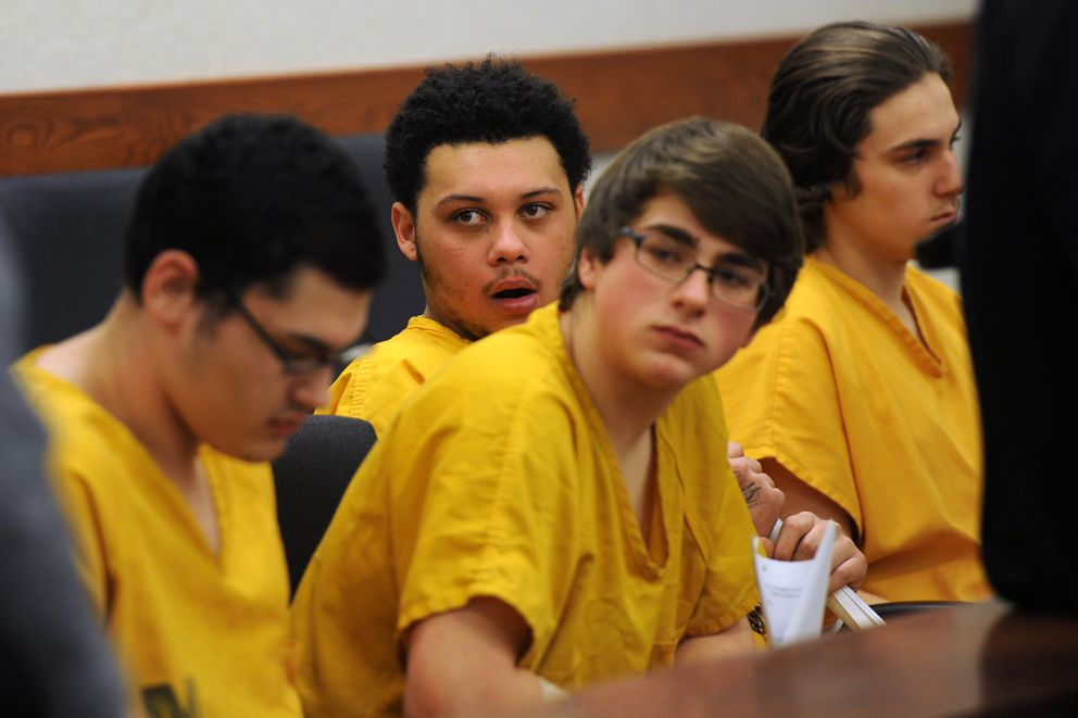 Bradley Renfro, center right, is seen during a Dec. 13 2016 court appearance with Austin Barrett, right, Devin Peterson, center left and Dominic Johnson, left, in Palmer Superior Court. (Erik Hill / Alaska Dispatch News)