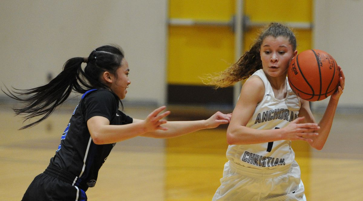 Thunder Mountain sophomore Mary Khaye Garcia puts pressure on ACS senior Mary-Kate Parks during the Lions' 66-44 victory. (Bill Roth / Anchorage Daily News).