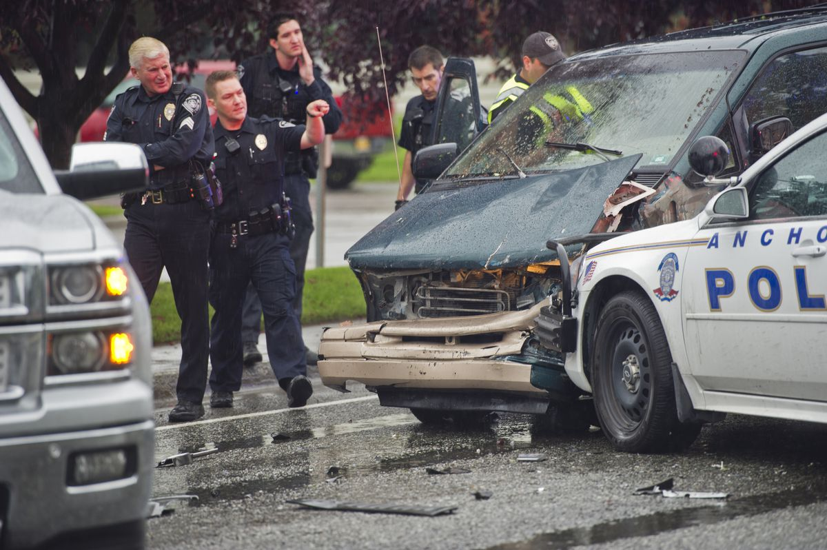 Anchorage police arrested one man aftera multiple-vehicle collision that involved police vehicles on C Street in Midtown on Monday, Aug. 22, 2016. (Marc Lester / Alaska Dispatch News)