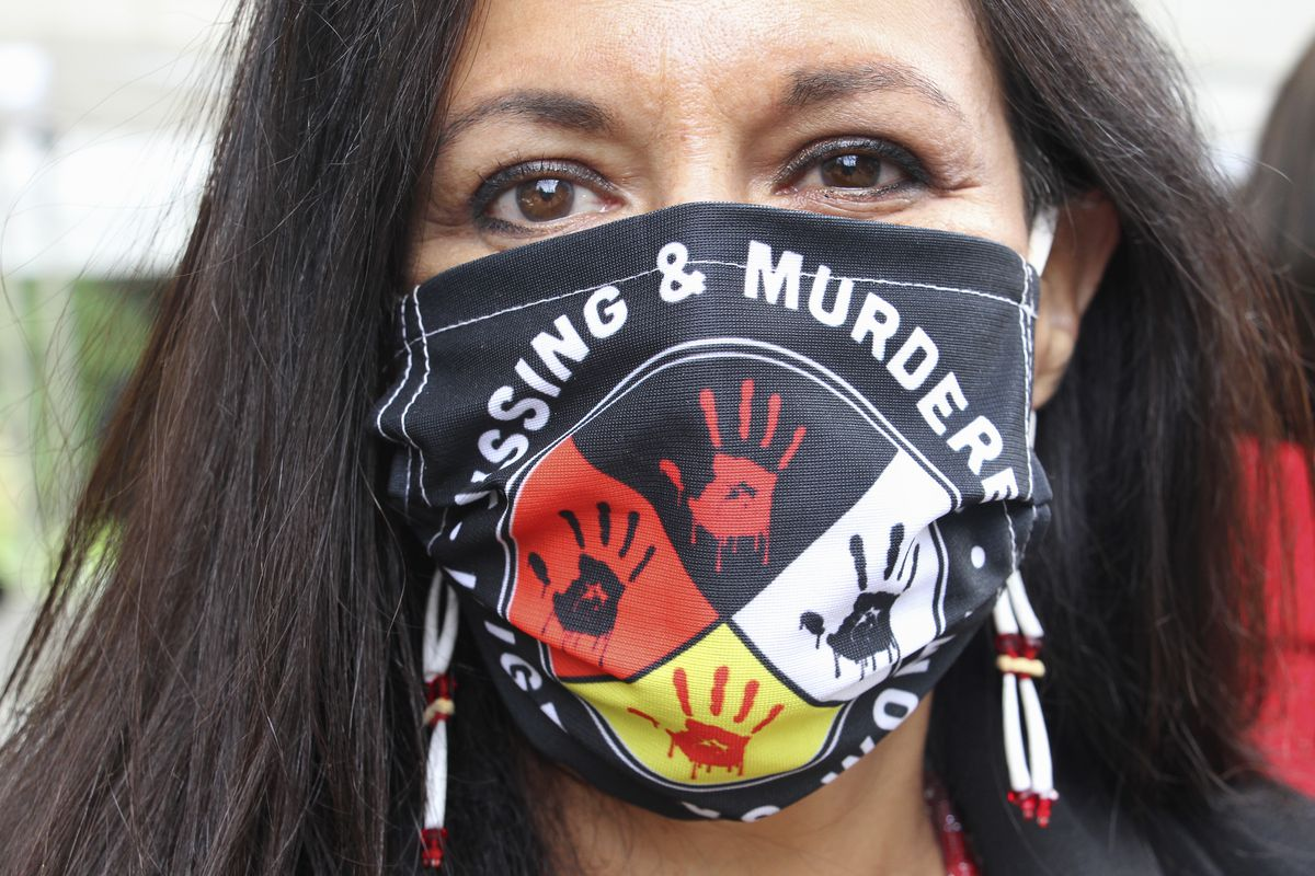 Jeannie Hovland, the deputy assistant secretary for Native American Affairs for the U.S. Department of Health and Human Services, poses with a Missing and Murdered Indigenous Women mask Wednesday. She attended the opening of a Lady Justice Task Force cold case office in Anchorage, which will investigate missing and murdered Indigenous women. (AP Photo/Mark Thiessen)