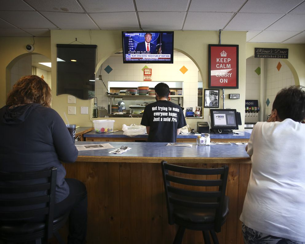 Jason Ritter, center, puts together a to-go order for a customer at Kriner's Diner in Anchorage on Aug. 3, 2020. (Emily Mesner / ADN)