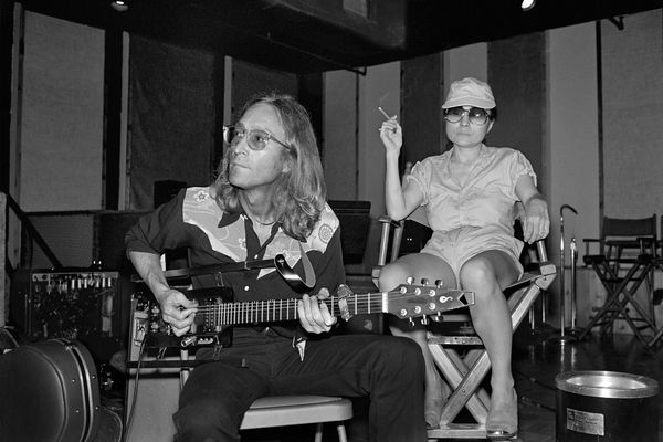 John Lennon noodles on his rare Sardonyx guitar while Yoko Ono enjoys a smoke at the Hit Factory in Manhattan on Aug. 7, 1980, the first day of recording for