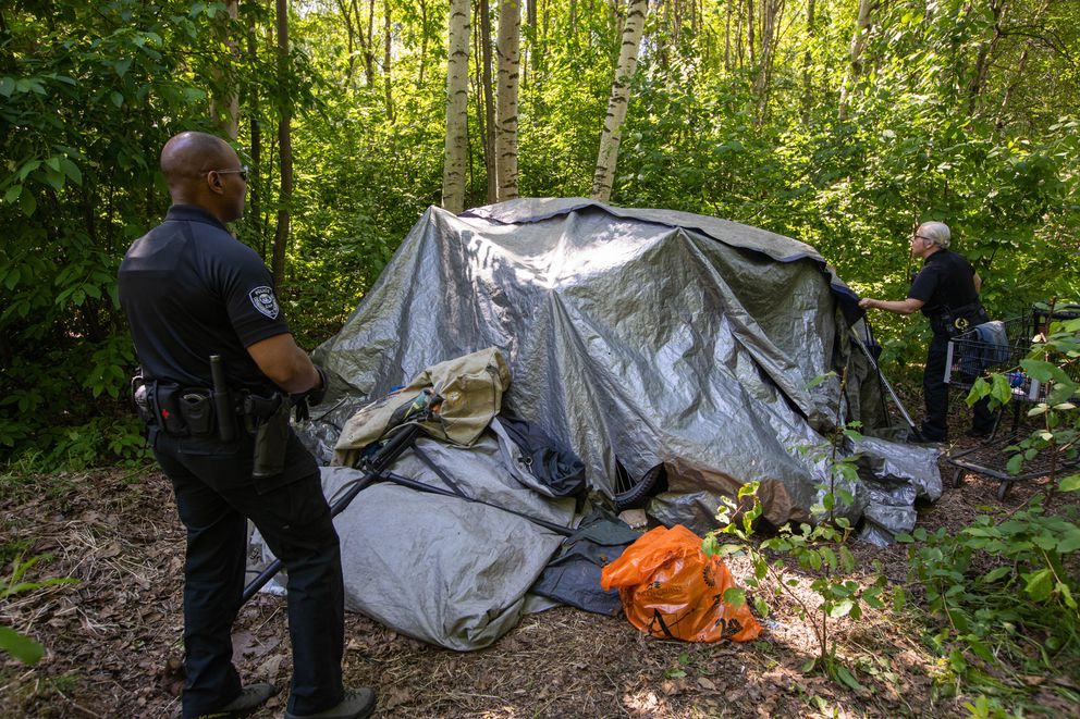 CAP officers Damon Jackson, left, and Natasha Welch make contact with Matthew Strametz Thursday, June 13, 2019 at his camp in the Chester Creek Greenbelt. (Loren Holmes / ADN)