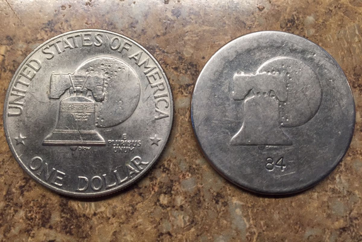 Gary Peters carried an Eisenhower dollar (right) in his pocket for 34 years. A newer coin (left) shows how much the coin has worn over the 34 years. Peters lost the coin, possibly in the Anchorage airport. (Photo provided by Gary Peters)