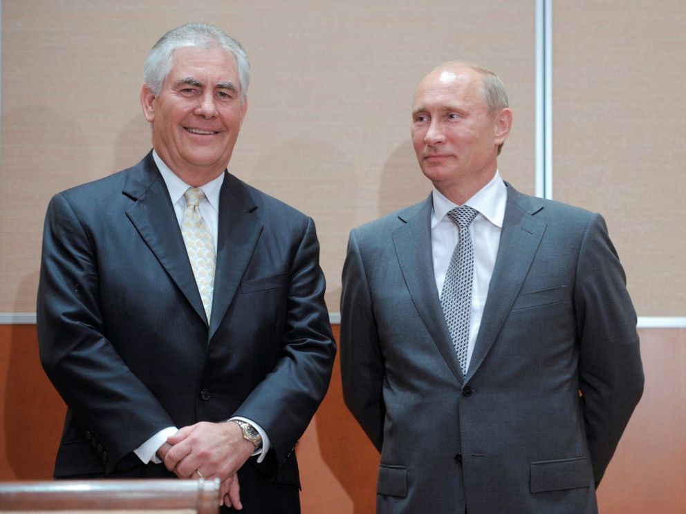 FILE – Russian Prime Minister Vladimir Putin and Exxon CEO Rex Tillerson look on at a signing ceremony for an oil exploration deal in the Black Sea resort of Sochi, August 30, 2011. REUTERS/Alexsey Druginyn/RIA Novosti/Pool