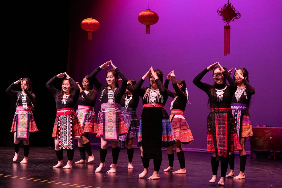 Bartlett Chinese language students perform a Hmong dance Friday. (Loren Holmes / ADN)