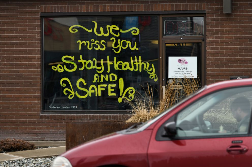 A message is painted on the window of The Beauty Room on Northern Lights Boulevard on April 16, 2020. (Marc Lester / ADN)